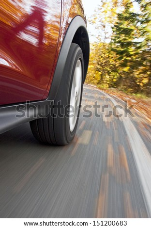 Driving a car in the autumn - stock photo
