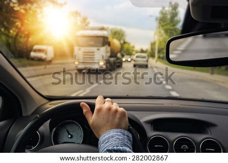 Driving a car in the city - stock photo
