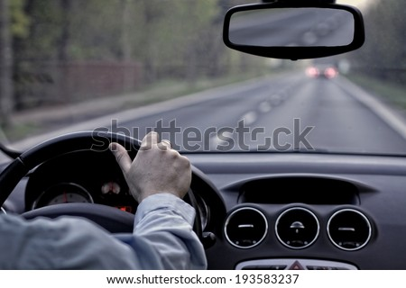 Driving a car on empty street - stock photo