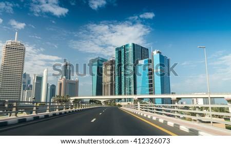 Driving across Dubai Downtown. - stock photo