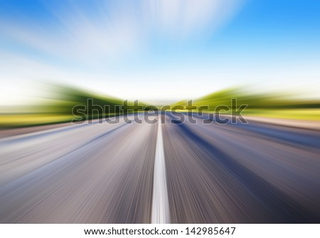 driving at high speed in empty road - motion blur - stock photo