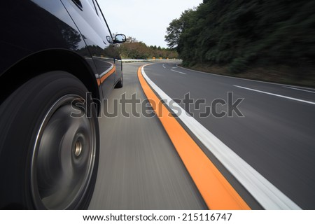 Driving at mountain road . - stock photo
