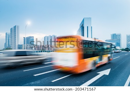 driving bus in city traffic in motion blur - stock photo