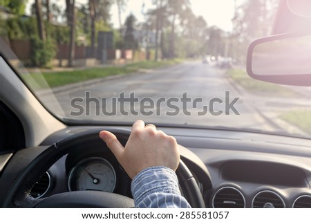 Driving car on empty streets - stock photo