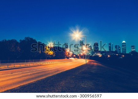 Driving in Houston at Night - stock photo