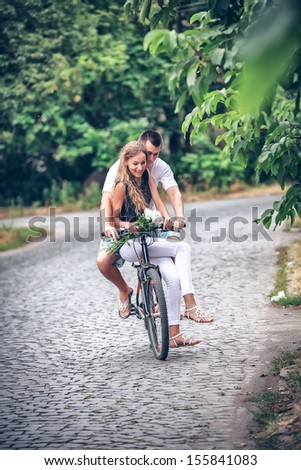 Driving of a young pair by bicycle down street cities - stock photo