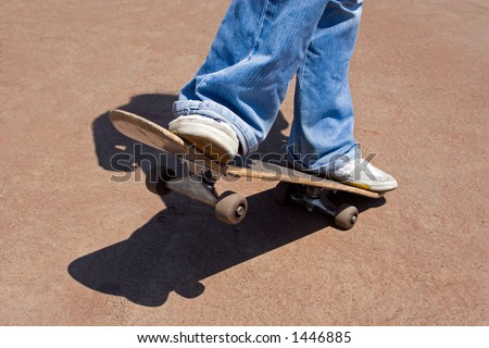 Driving on a skateboard on asphalt. - stock photo