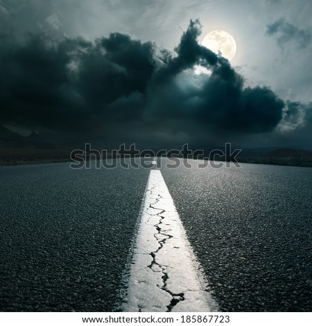 Driving on an empty asphalt road at night of full moon - stock photo