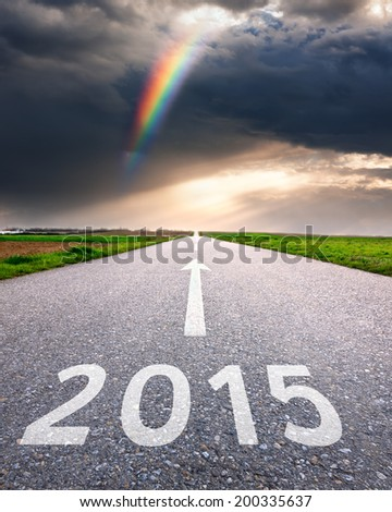 Driving on an empty asphalt road forward to the new 2015  - stock photo