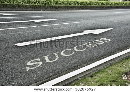 Driving on an empty asphalt road towards the destination and sign which symbolises success. Concept creative for success. - stock photo