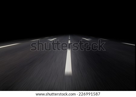 driving on asphalt by night - stock photo