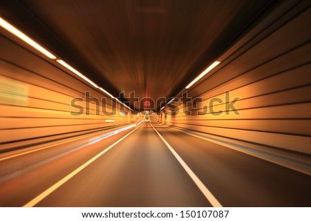Driving on the night road - stock photo