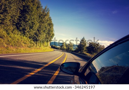 Driving on the Norway road. Summer village landscape with road and car. Road trip journey. - stock photo