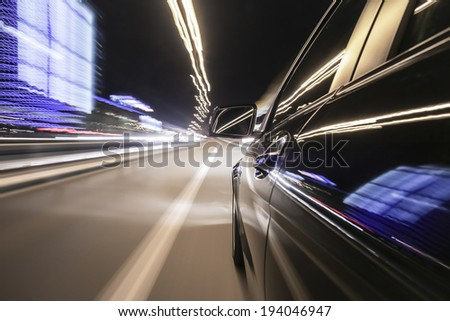 driving through Munich, during night, rigged camera on the side of a german black car, bulb exposure - time-lapse, special effects photography - stock photo