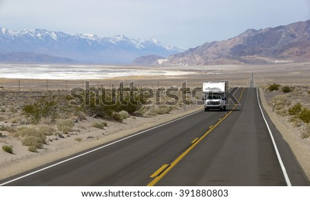 DRIVING TO THE DEATH VALLEY ON HWY 190, March 3, 2016: Camper truck is driving to the Death Valley Superbloom - stock photo