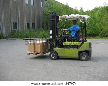Driving truck with pallet - stock photo