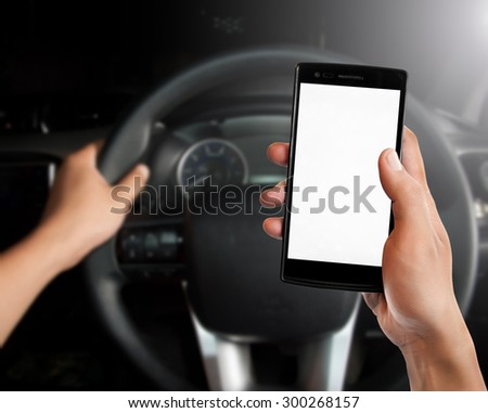 Driving while holding a mobile phone,transportation and vehicle concept - stock photo