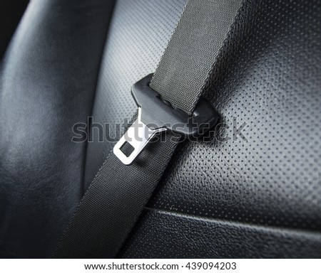 Driving with unfastened seat belt - stock photo