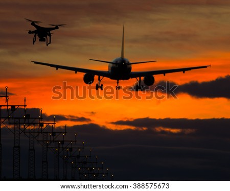 Drone flying near commercial airplane - stock photo