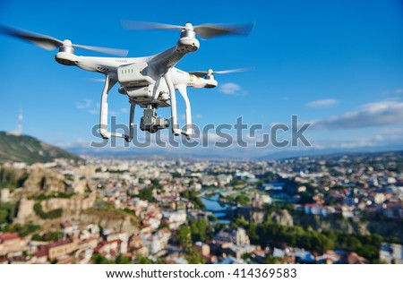 drone quadcopter with digital camera - stock photo