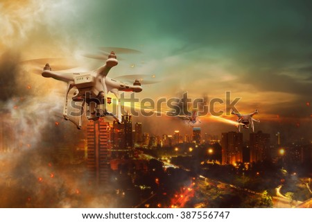 Drones battle over the city at night time - stock photo