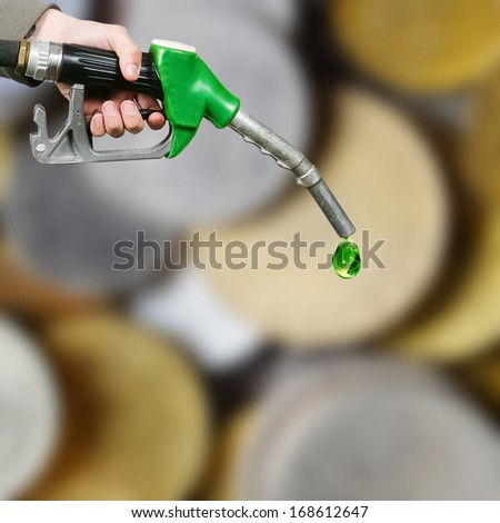 Drop of green fuel on euro coins background - stock photo