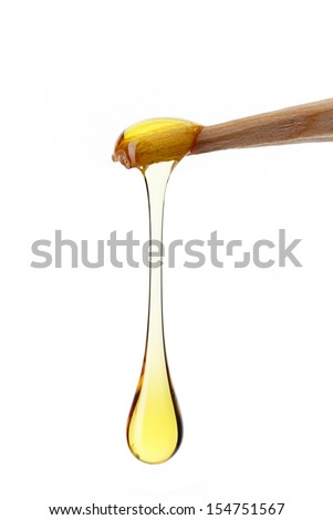 drop of honey on a white background - stock photo