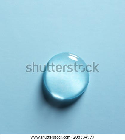 drop of water on a blue background - stock photo