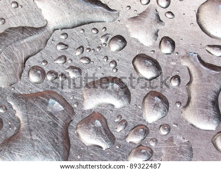 Drop of water on metal. Abstract composition - stock photo