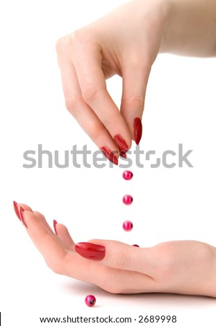Droping bead. Woman hands isolated on white. - stock photo