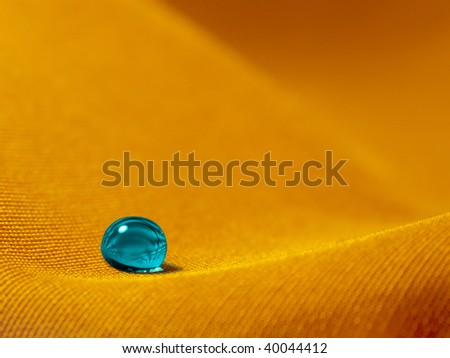 Droplet on the sand - stock photo