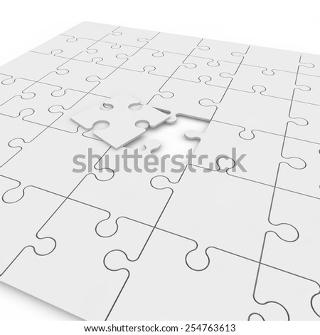Dropped white puzzle of puzzles - stock photo
