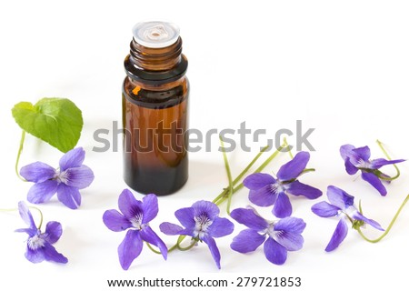 Dropper bottle of bach flower essence on white background with blossoms - stock photo