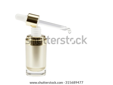 Dropper of essential oil, aromatherapy essence, or medicinal liquid - stock photo