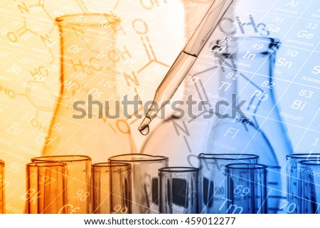 dropping chemical liquid to test tubes, laboratory research and development concept  - stock photo