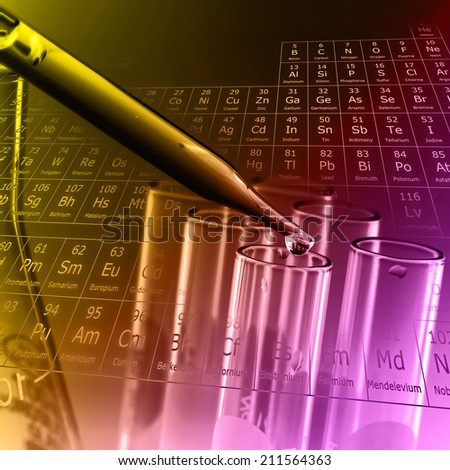 Dropping liquid to test tube with periodic table of elements background - stock photo