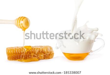 drops of milk and honey - stock photo