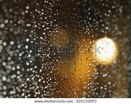 Drops of night rain on window - stock photo