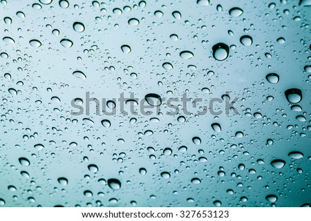 Drops of rain on a window glass. - stock photo