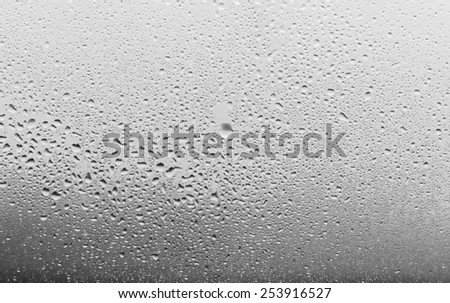Drops of rain on the inclined window (glass) - stock photo
