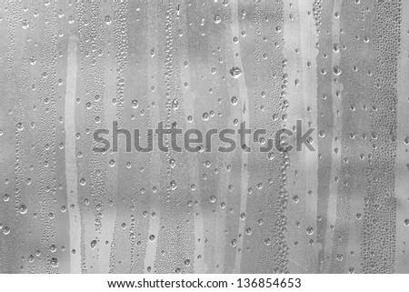 Drops of rain on the window. - stock photo