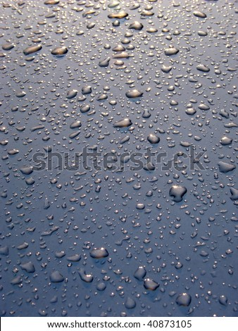 Drops of water on a surface of the car after a rain. - stock photo