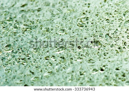 Drops of water on glass abstract background. - stock photo