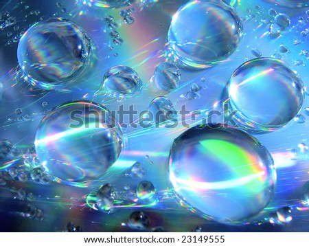 Drops of water on the compact disk - stock photo