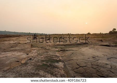 Drought and sunset - stock photo