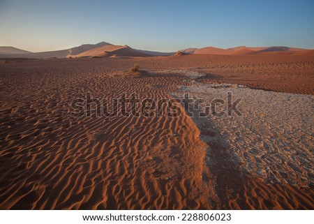 Drought cracked soil, Sossusvlei, Namibia - stock photo