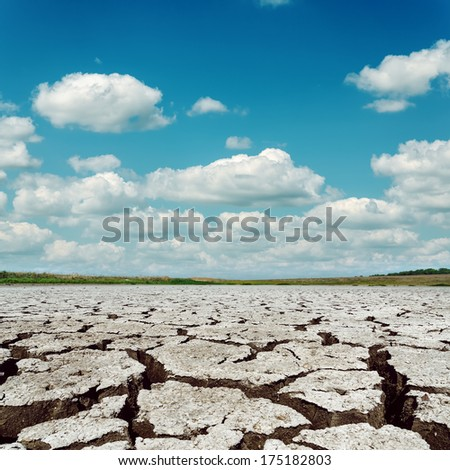 drought earth and dramatic sky with clouds - stock photo