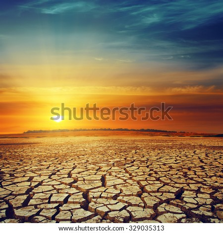 drought land and sunset over it - stock photo