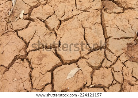 Drought, surface of a grungy cracking dried mud floor, climate change, natural disaster and catastrophe - stock photo