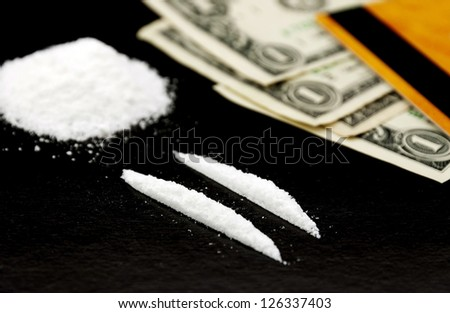 Drud and money - stock photo